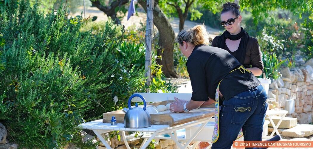 Lara Dunston learning to make pizza in Alberobello, Puglia, Ital