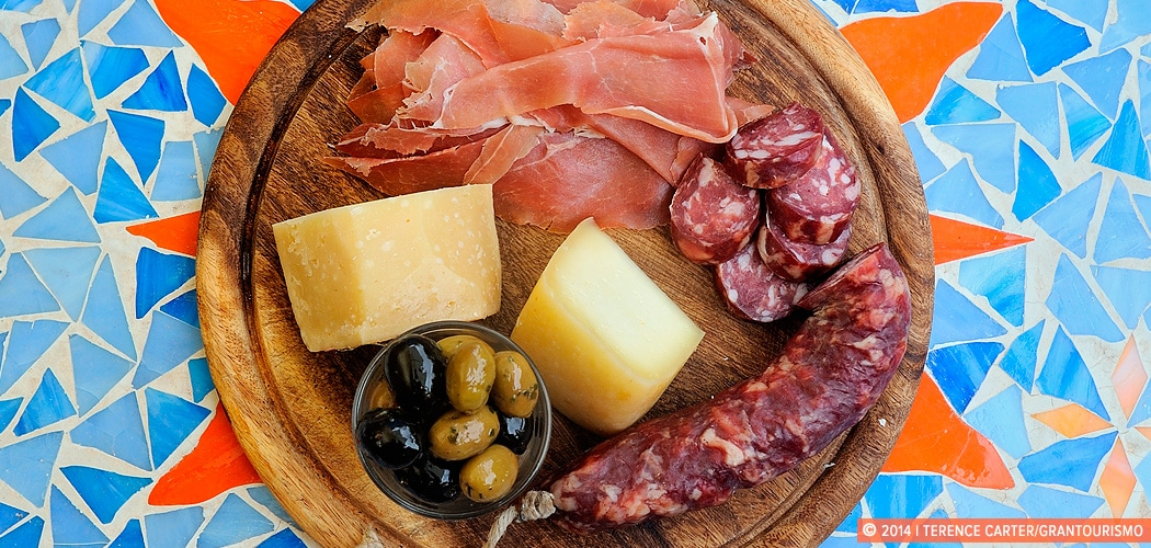 Sardinian Specialties include Cheese & Charcuterie, Bottarga, Honey, Biscuits, Sardinian Wine, Myrtle Liquor. Teulada, Sardinia, Italy. Copyright 2014 Terence Carter / Grantourismo. All Rights Reserved.