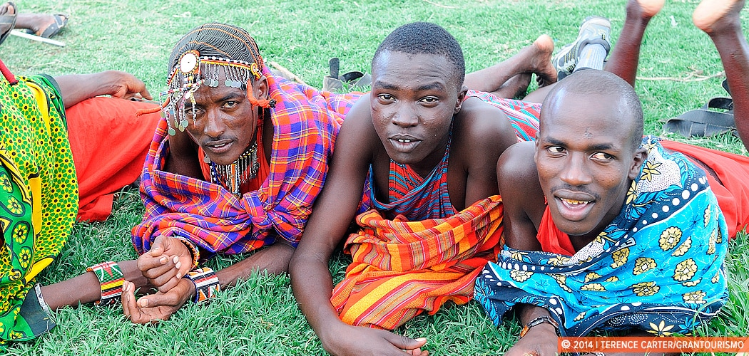 Tribesmen of a Maasai village close to the Sarova Mara in the Masai Mara, Kenya. Learning Swahili from the Locals. Copyright 2014 Terence Carter / Grantourismo. All Rights Reserved.