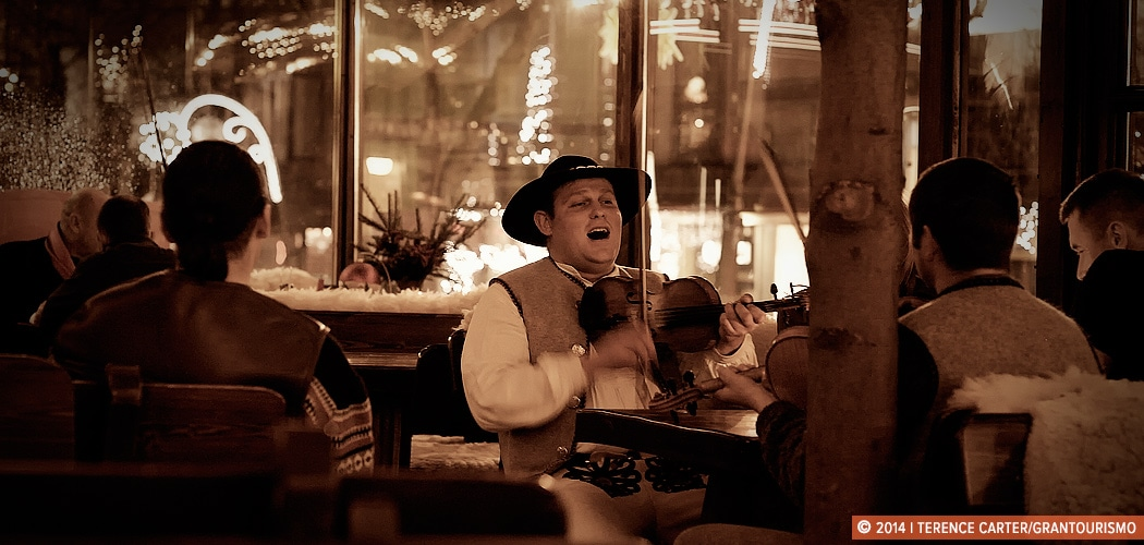 Folk Music in Zakopane. Folk music being played in bars on the main street of the old town of Zakopane in winter, Poland. Copyright 2014 Terence Carter / Grantourismo. All Rights Reserved.