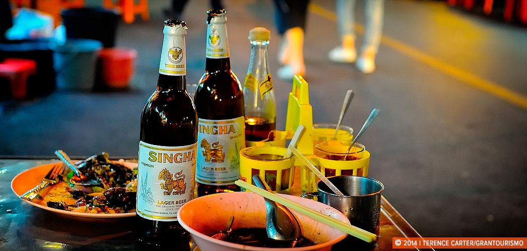 Singha beer and street food, Bangkok. Bangkok Shopping List — what things cost in Bangkok. Copyright 2014 Terence Carter / Grantourismo. All Rights Reserved.