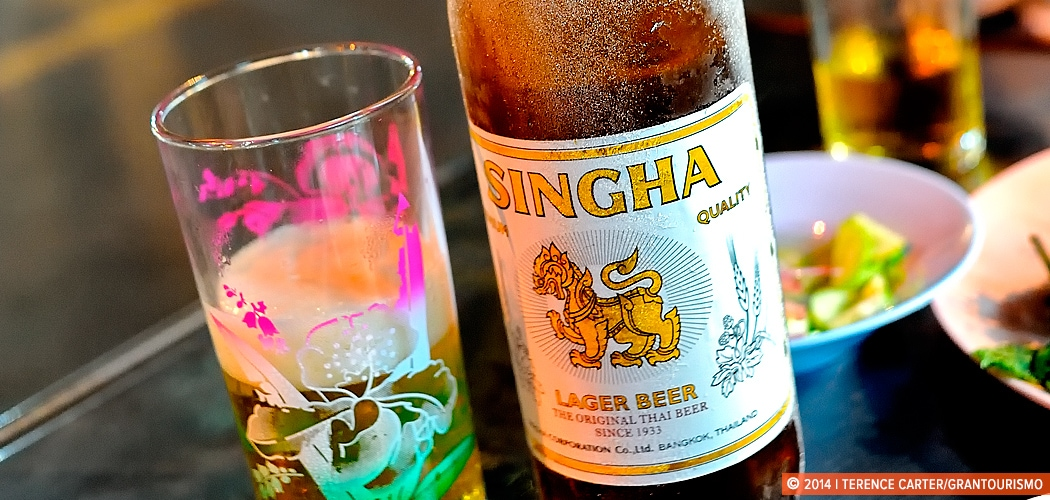 Sipping Singha Beer in Bangkok. Soi 38, Thong Lor, Bangkok. Copyright 2014 Terence Carter / Grantourismo. All Rights Reserved.