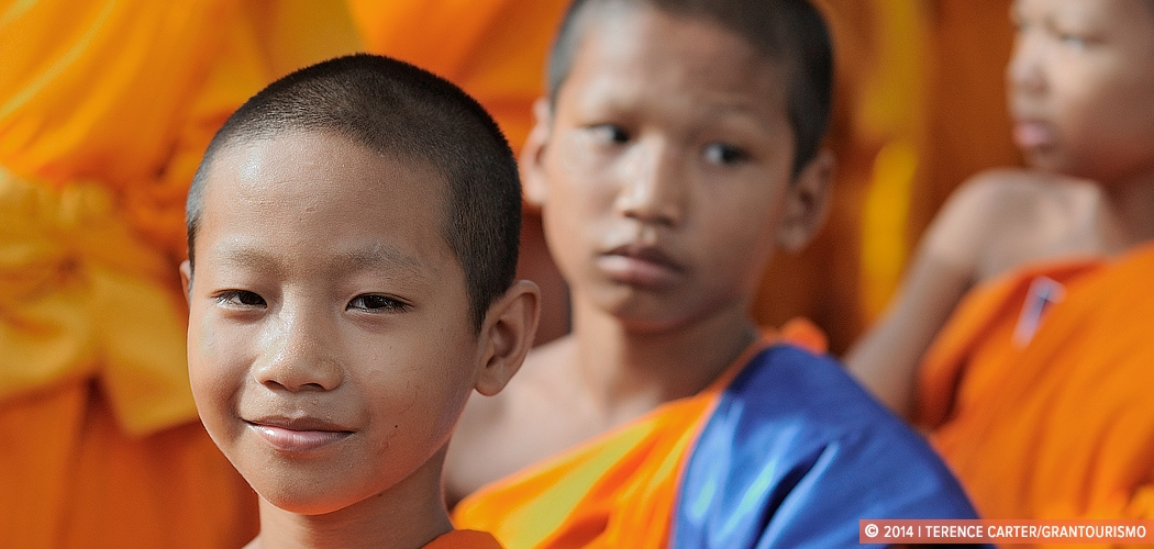 Novice monks gather in Bangkok for Visakha Bucha Day. Bangkok, Thailand. Copyright 2014 Terence Carter / Grantourismo. All Rights Reserved.