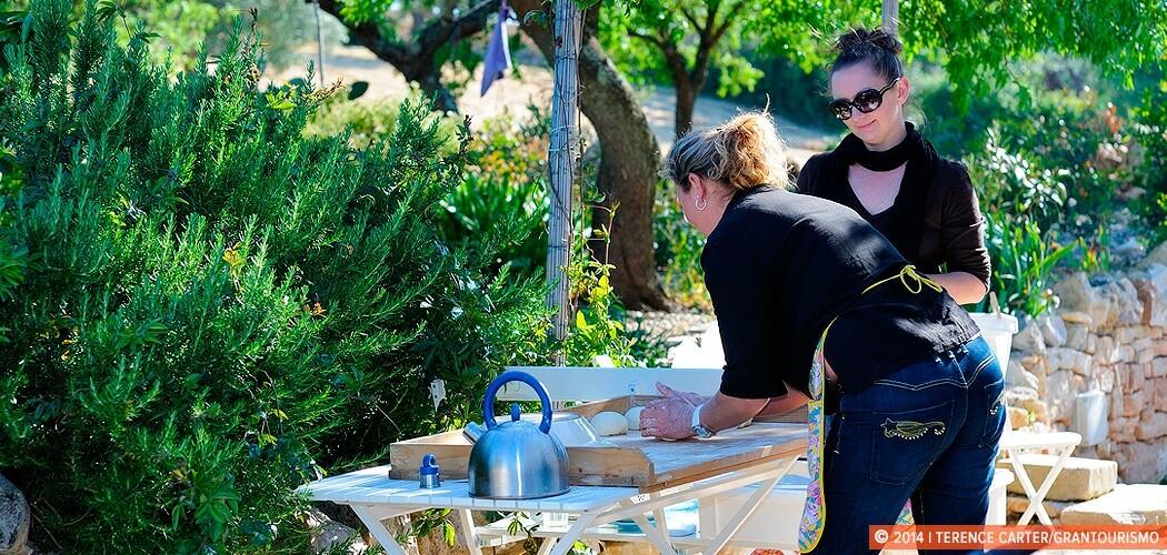 Making pizza in a Trulli in Alberobello, Puglia, Italy.