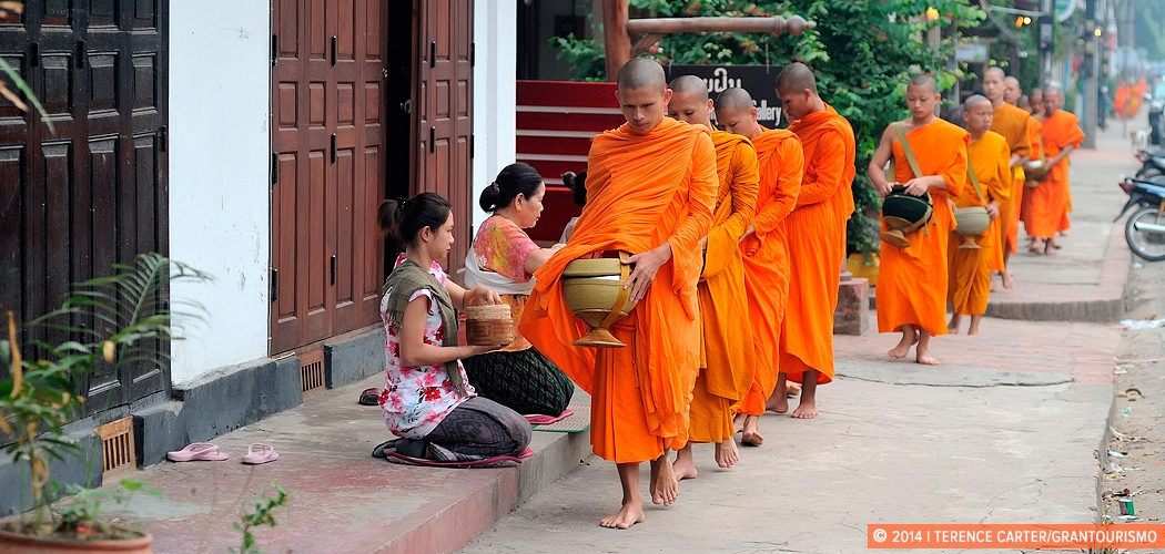 Early Morning Alms Giving to the Monks in Luang Prabang, Laos. Copyright 2014 Terence Carter / Grantourismo. All Rights Reserved.