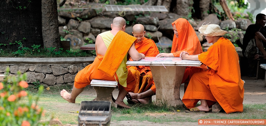 Monks in a Luang Prabang Temple. Touring the Temples of Luang Prabang, Laos. Copyright 2014 Terence Carter / Grantourismo. All Rights Reserved.