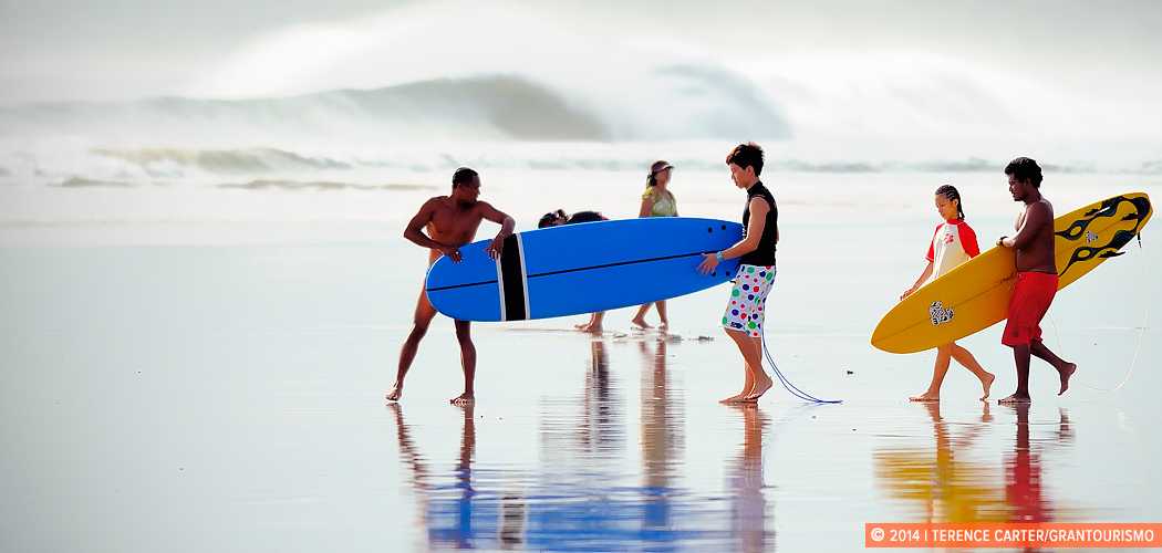 Surfing at Kuta Beach, Bali, Indonesia. Copyright 2014 Terence Carter / Grantourismo. All Rights Reserved.
