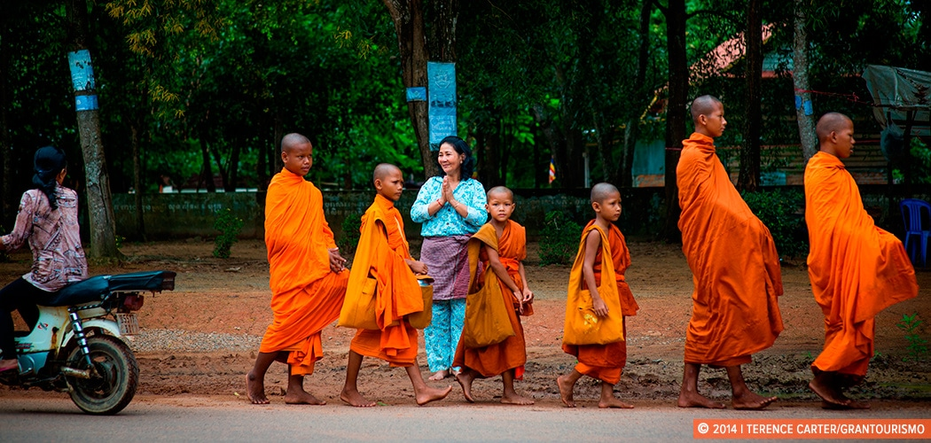 Monks collecting alms in the countryside, Siem Reap, Cambodia. Copyright 2014 Terence Carter / Grantourismo. All Rights Reserved. Responsible travel in Cambodia.