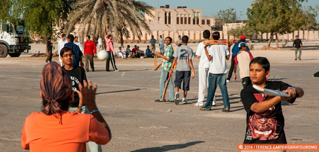 Kids playing cricket near Dubai Creek, Dubai, UAE.