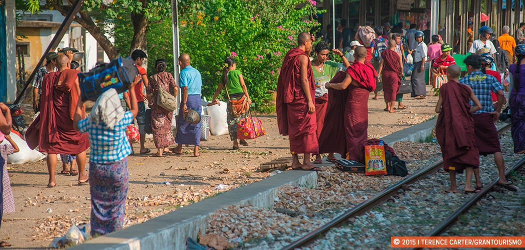 Monks at a station, photographed from the Yangon-Mandalay train. Myanmar. Copyright 2015 Terence Carter / Grantourismo. All Rights Reserved. yangon to mandalay by train.