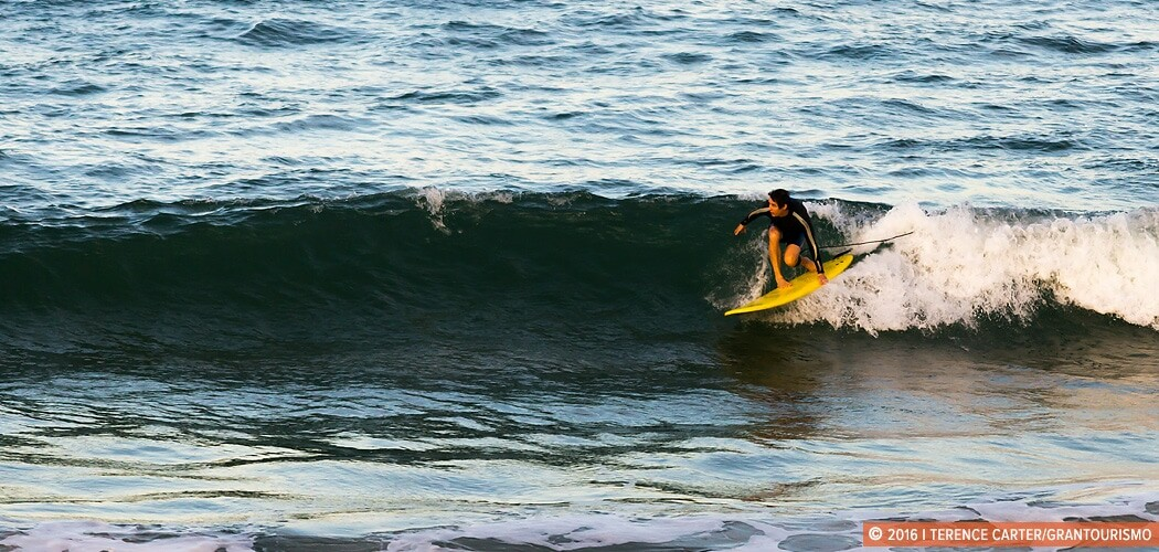 A surfer gets a late afternoon ride at Burleigh Heads