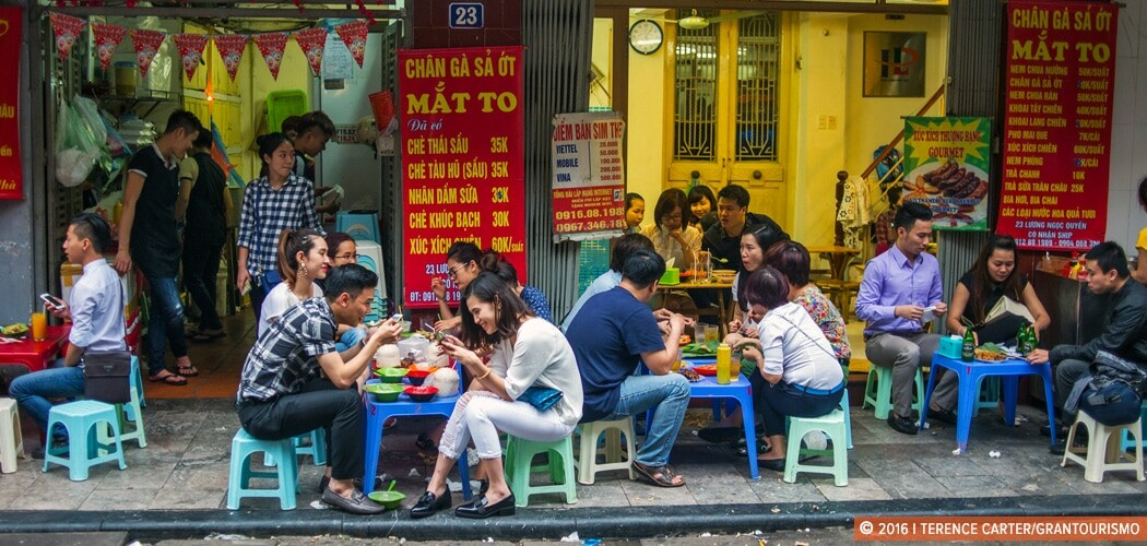 Eating on the streets of Hanoi, Vietnam.