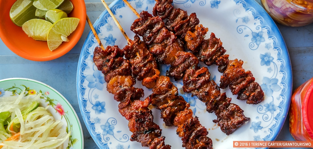 Pork Skewers, Road 60, Siem Reap, Cambodia. Copyright 2016 Terence Carter / Grantourismo. All Rights Reserved. Best Camera and Lens for Travel and Food Photography.