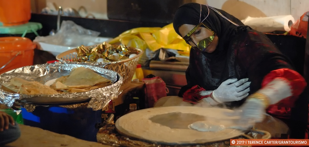 A local Emirati woman making 'regag', large, paper-thin crispy crepe-like bread at Heritage Village, Dubai Creek, UAE. Copyright 2017 Terence Carter / Grantourismo. All Rights Reserved. Dubai Street Food.
