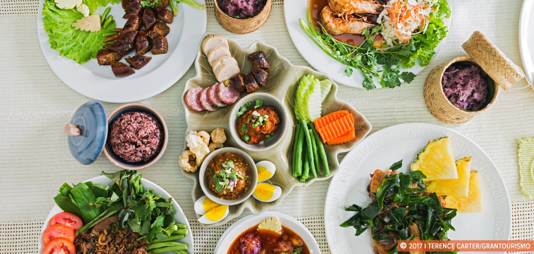 Northern Thai Lanna Food spread in Chiang Mai, Thailand. Copyright 2017 Terence Carter / Grantourismo. All Rights Reserved. Where to Eat in Chiang Mai for the Best Northern Thai Lanna Food.
