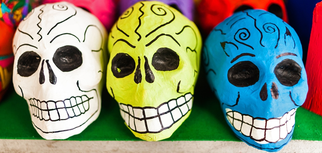 Painted skeleton heads. Mercado la Ciudadela, Mexico City, Mexico. Day of the Dead. Copyright © 2017 Terence Carter / Grantourismo. All Rights Reserved.