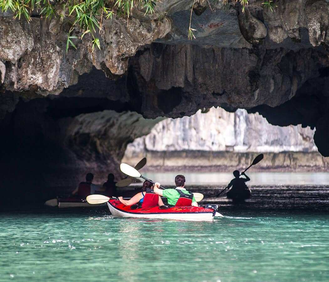 Kayaking on Halong Bay, Vietnam. Copyright © 2019 Terence Carter / Grantourismo. All Rights Reserved. Vietnam Cuisine and Culture Tour 2019.